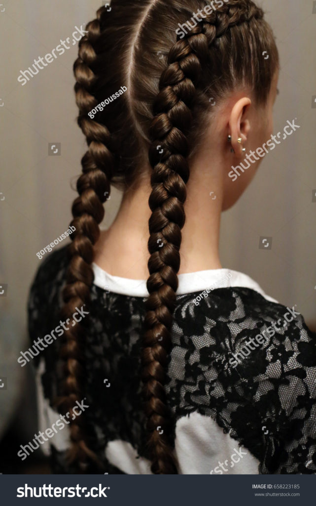 Long braided hairstyles trends 2020 double brown Inside Out Fishtail Braid.
