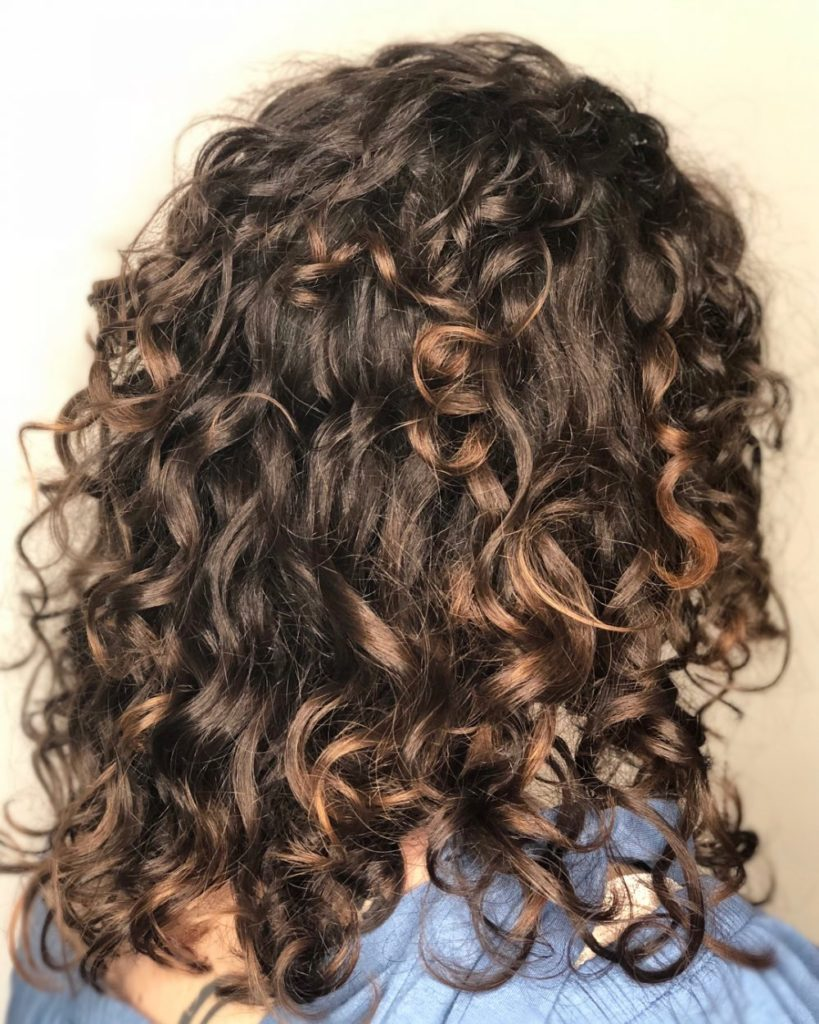Medium Teens Haircuts trends 2020 curly brunette 4