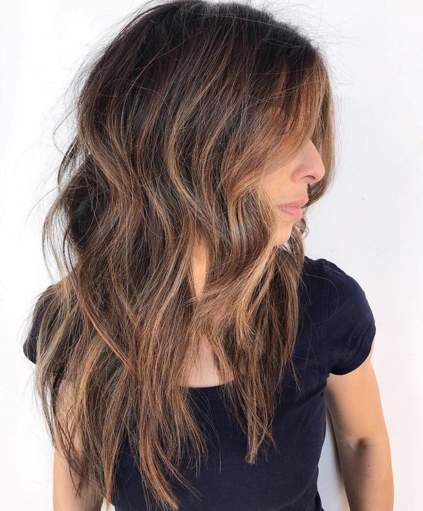 Long Highlights Hairstyles trends 2020 Caramel blonde wavy hair 2