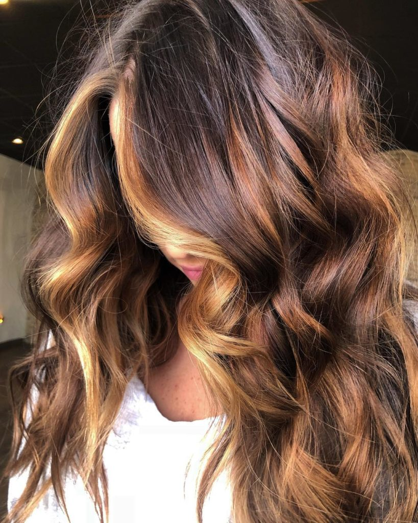 Long Highlights Hairstyles trends 2020 caramel curls