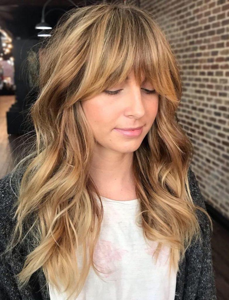 Long Shag Haircuts trends 2020 caramel Choppy layers