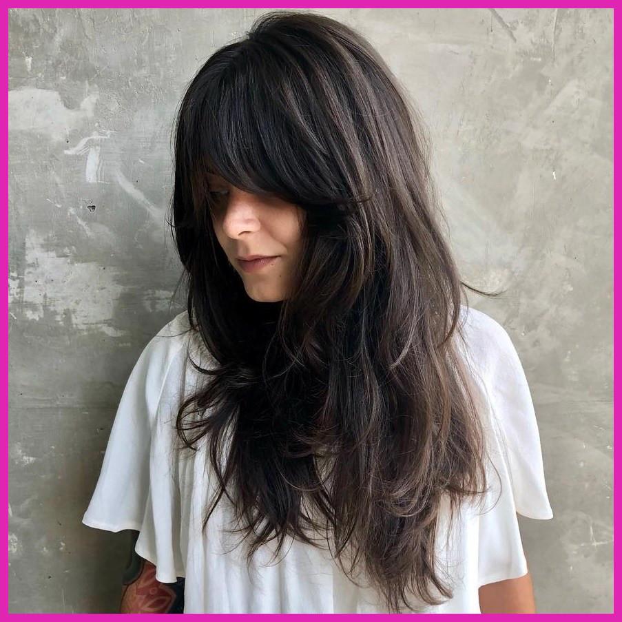 Long Shag Haircuts trends 2020 dark brown Choppy layers