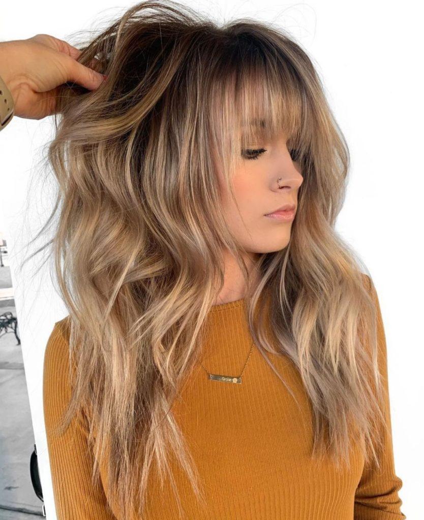 Long Shag Haircuts trends 2020 messy blonde with bang
