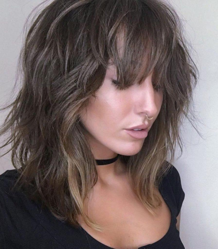 Long Shag Haircuts trends 2020 messy dark chocolate