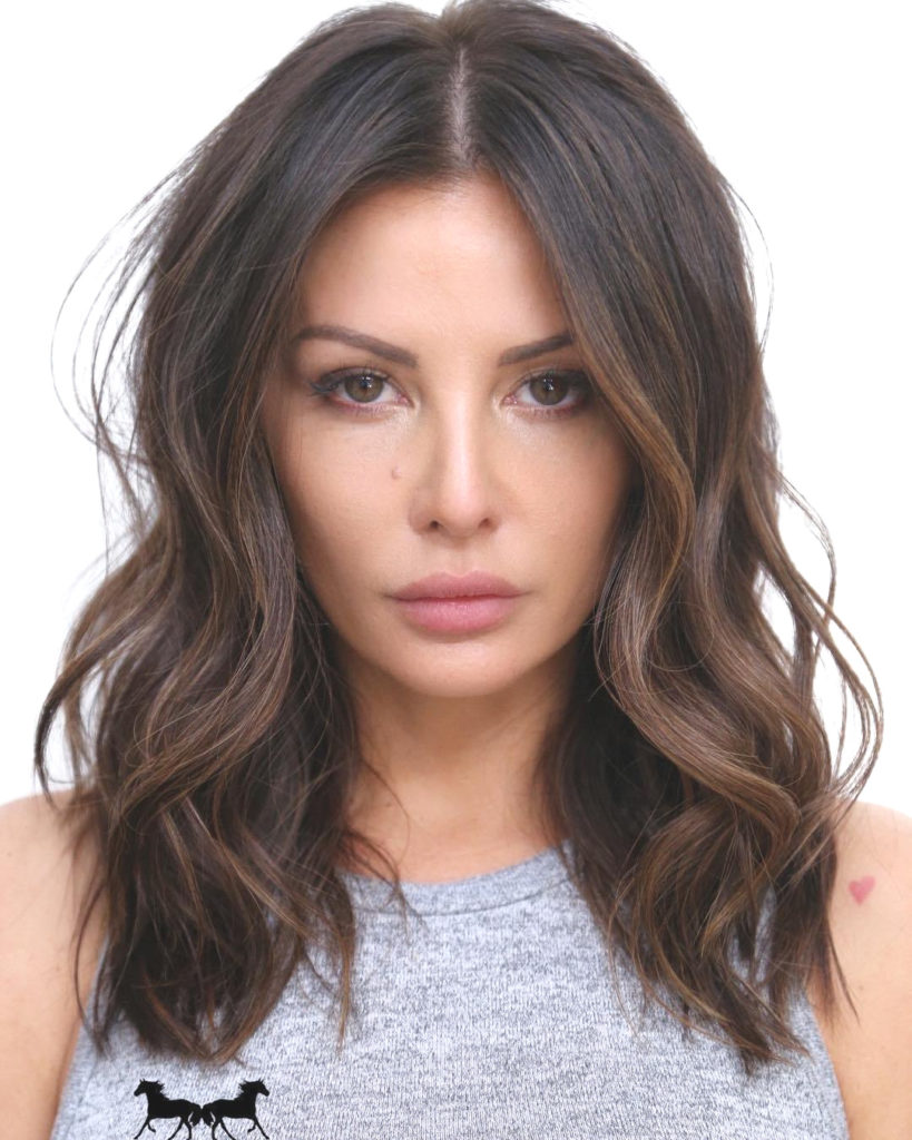 Medium Highlights Hairstyles trends 2020 dark chocolate brown hue 1