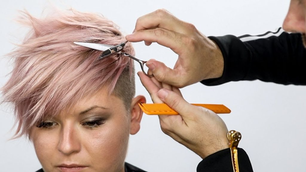 Medium Pixie Haircuts trends 2020 hairstylist taking care of a soft pink pixie cut