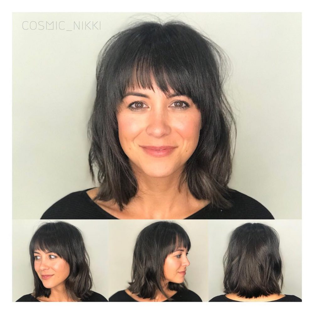 Medium Shag Haircuts trends 2020 Leathher black color with bang haircut