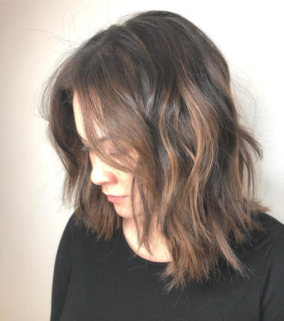 Medium Shag Haircuts trends 2020 messy dark brown with caramel highlights