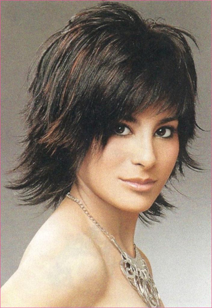 Short Shag Haircuts trends 2020 Dark choppy layered bang hairstyle