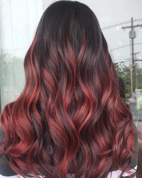 Edgy Red Highlights on Dark Hair