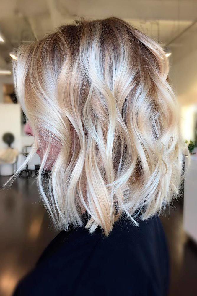 Glamorous Mid Length Blonde Bombshell