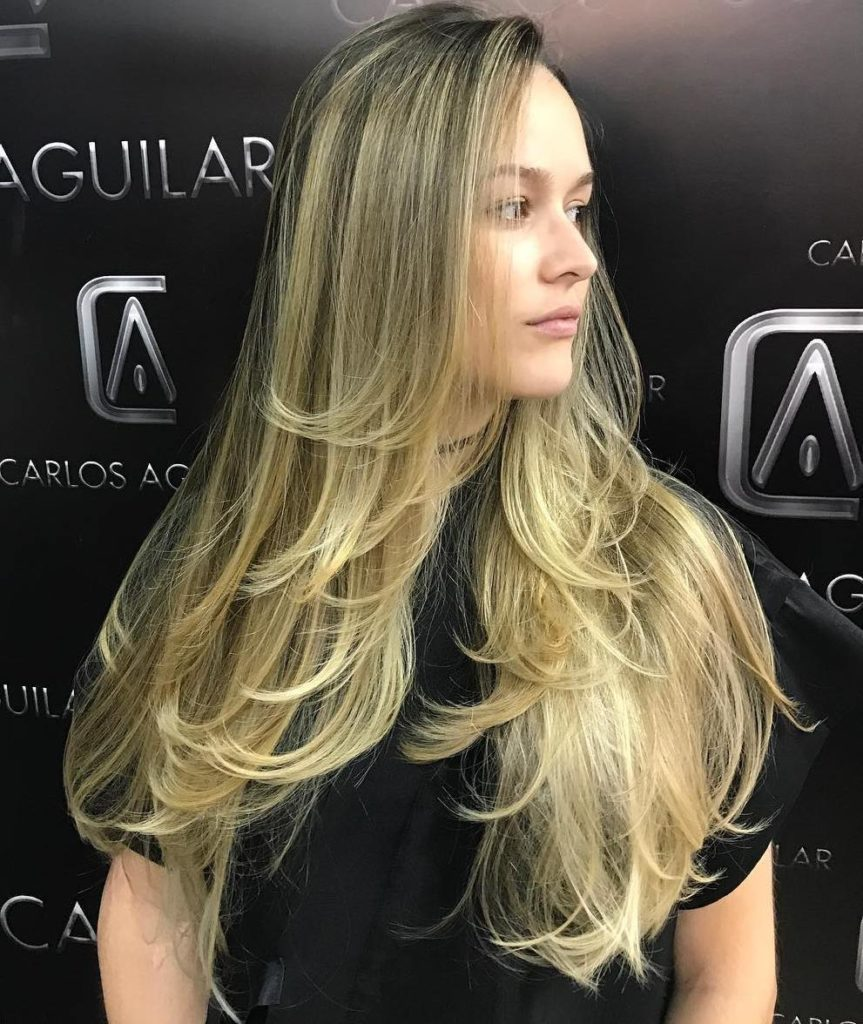 Long Blonde Hair with Soft Feathery Layers.