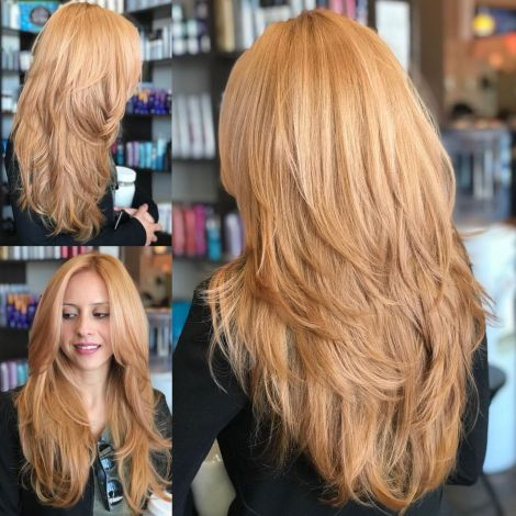 Long Feathered Strawberry Blonde Cut