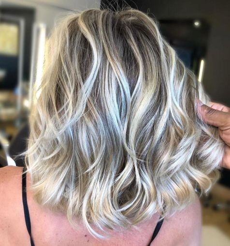 Medium Blonde Hairstyle with Bright Highlights 1