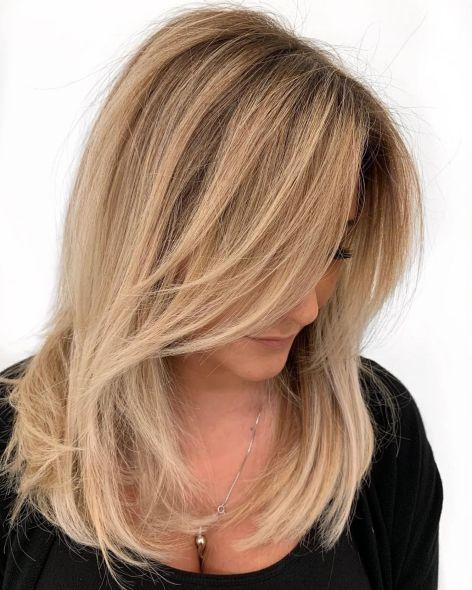 Medium Wispy Caramel Blonde Hairstyle