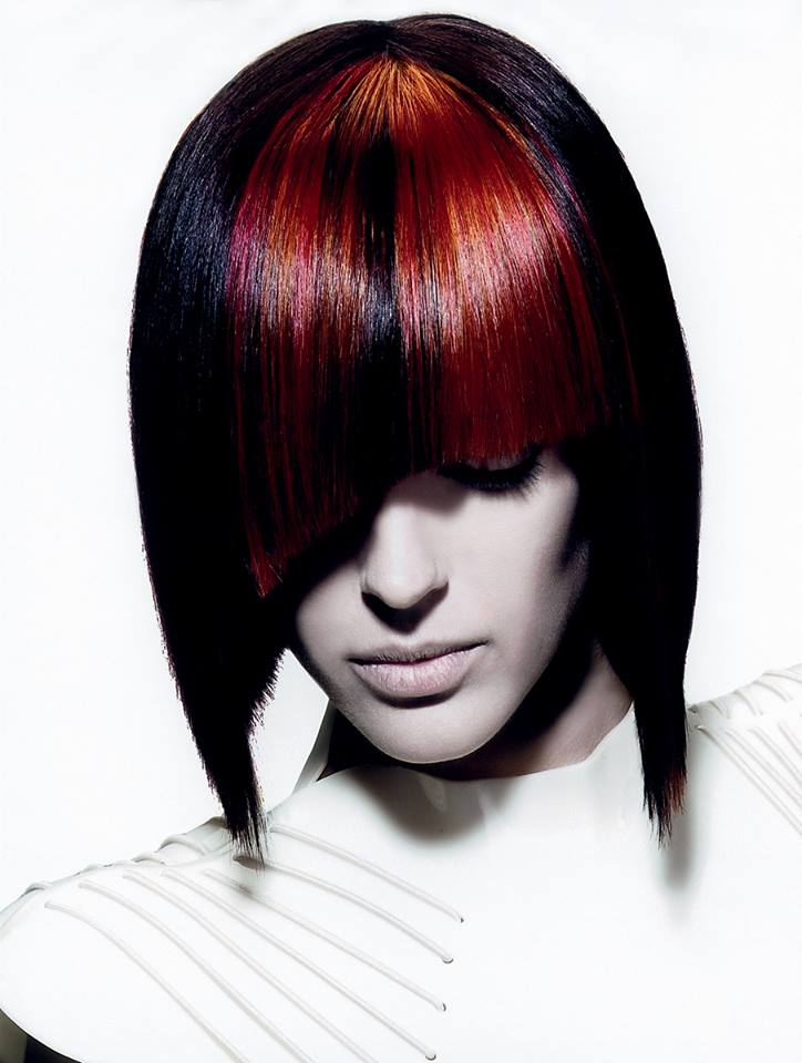 Medium dark red hairstyle with irregular bangs like in Cleopatra bob