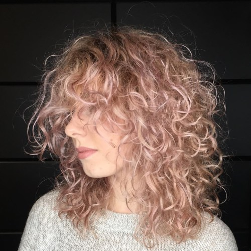 Mid Length Light Pastel Pink Curly Hairstyle