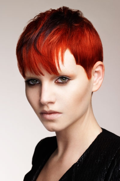 Pixie looking hairstyle with regular line up sides and wispy bangs for red haired women