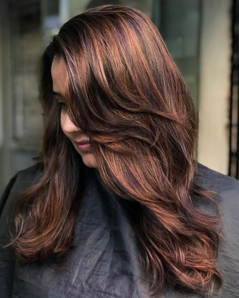 Rich Brunette Shag with Dynamic Waves