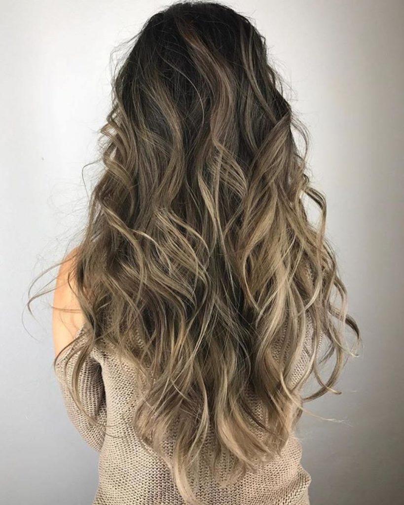 Waist Length Curly Hair with Highlights