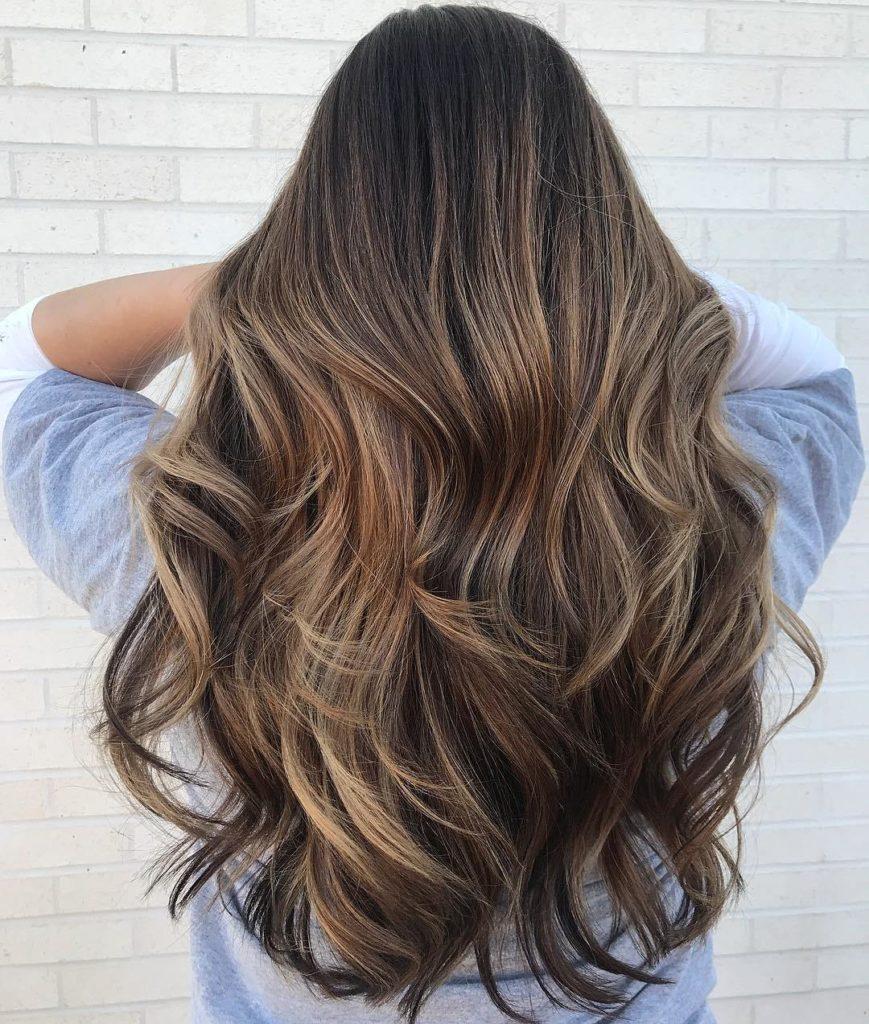 Waist Length Wavy Hair with Light Brown Streaks