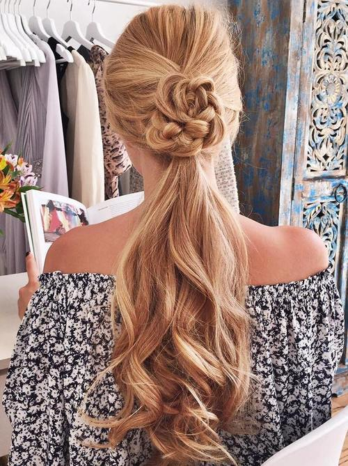 Wavy Ponytail with a Braided Flower