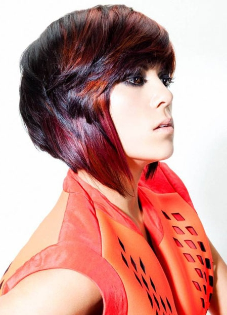 hort red hairstyle with longer sides and side swept fringe