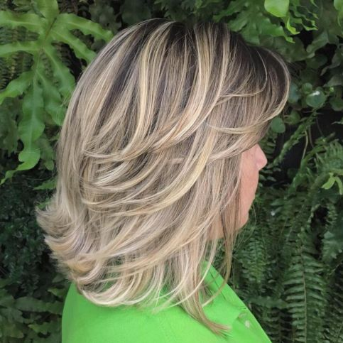 medium Hairstyle with Backswept Layers 1
