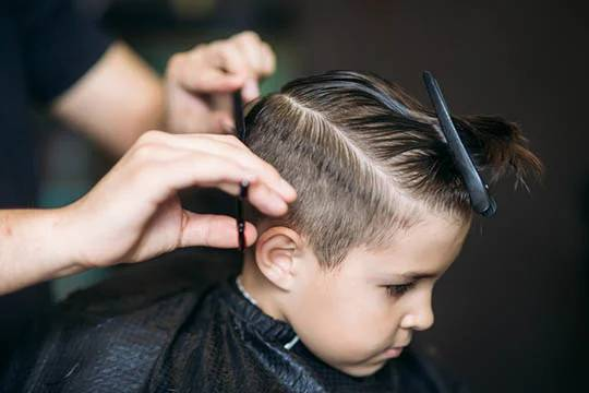 a boy's shaved temple
